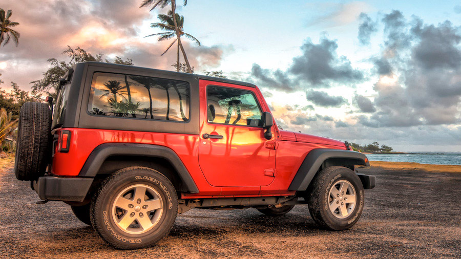 Rental Jeep on Beach in the Hawaiian Islands