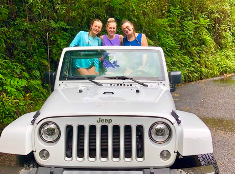 Three people in a Jeep from Dollar