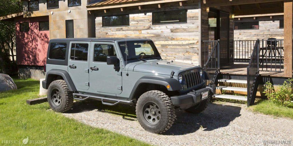 Jeep Wrangler rental parked near Wyoming cabin