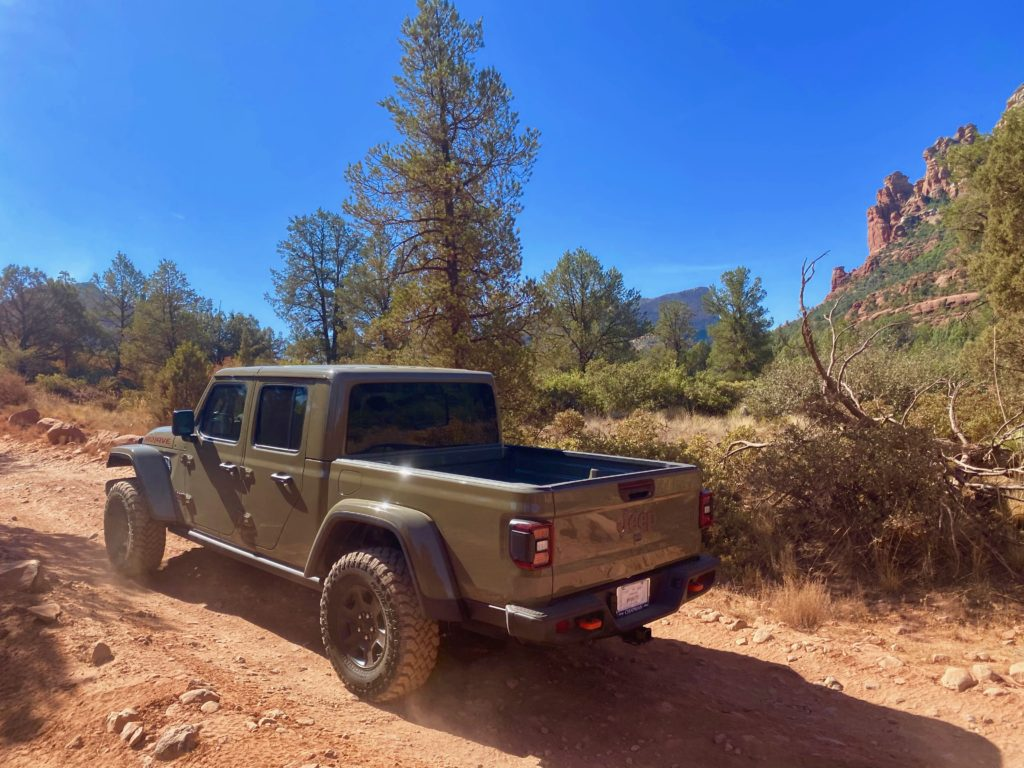 Jeep pickup truck rental driving on Broken Arrow trail in Sedona