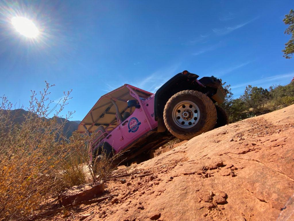 Pink Wrangler ascending the red rocks