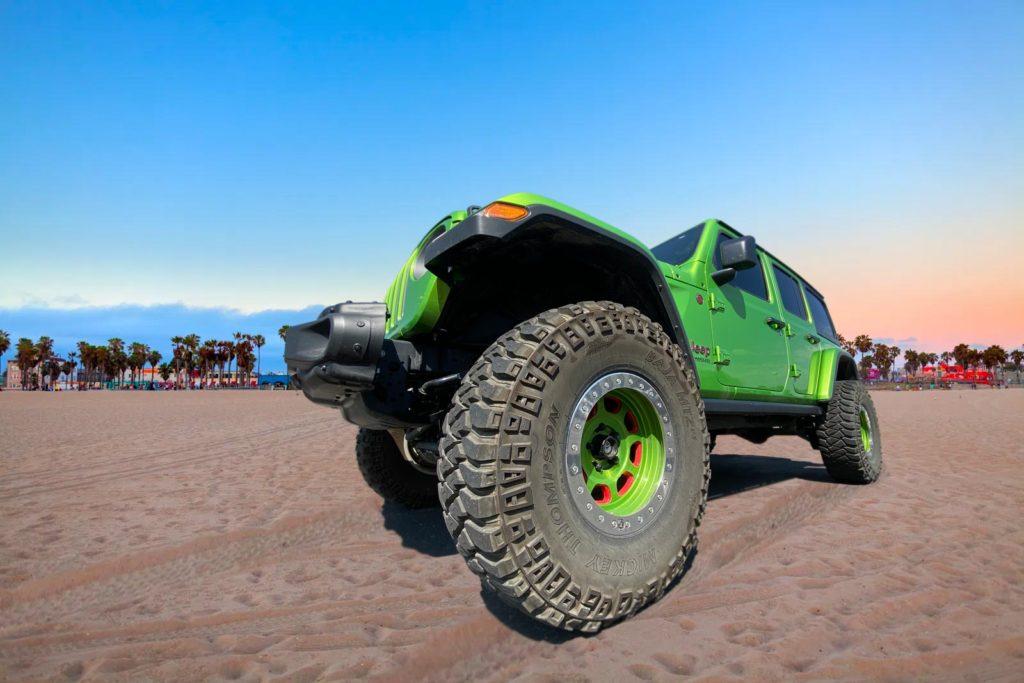 Green Jeep on a beach in California